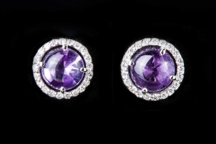 Amethyst stone surrounded by diamonds earrings