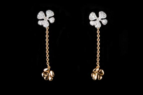 two flowers on the chain with diamond earrings